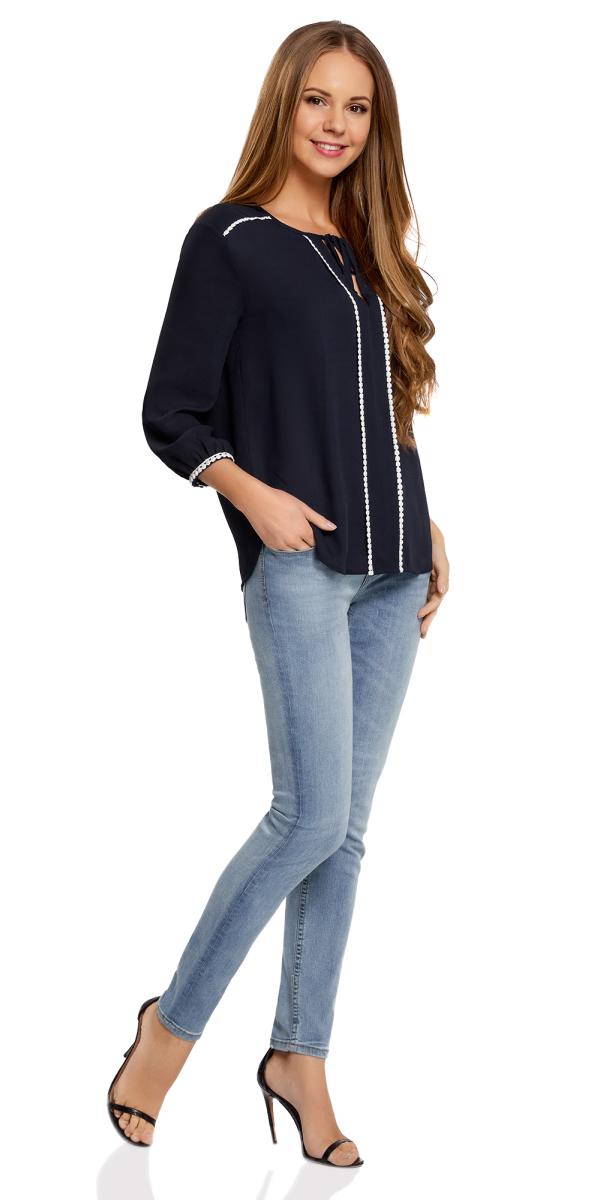 Блузка11411147/36215/7900NБлузка женская oodji Ultra выполнена из высококачественного материала. Модель с круглым вырезом горловины дополнена завязками. Блузка оформлена декоративной отделкой.