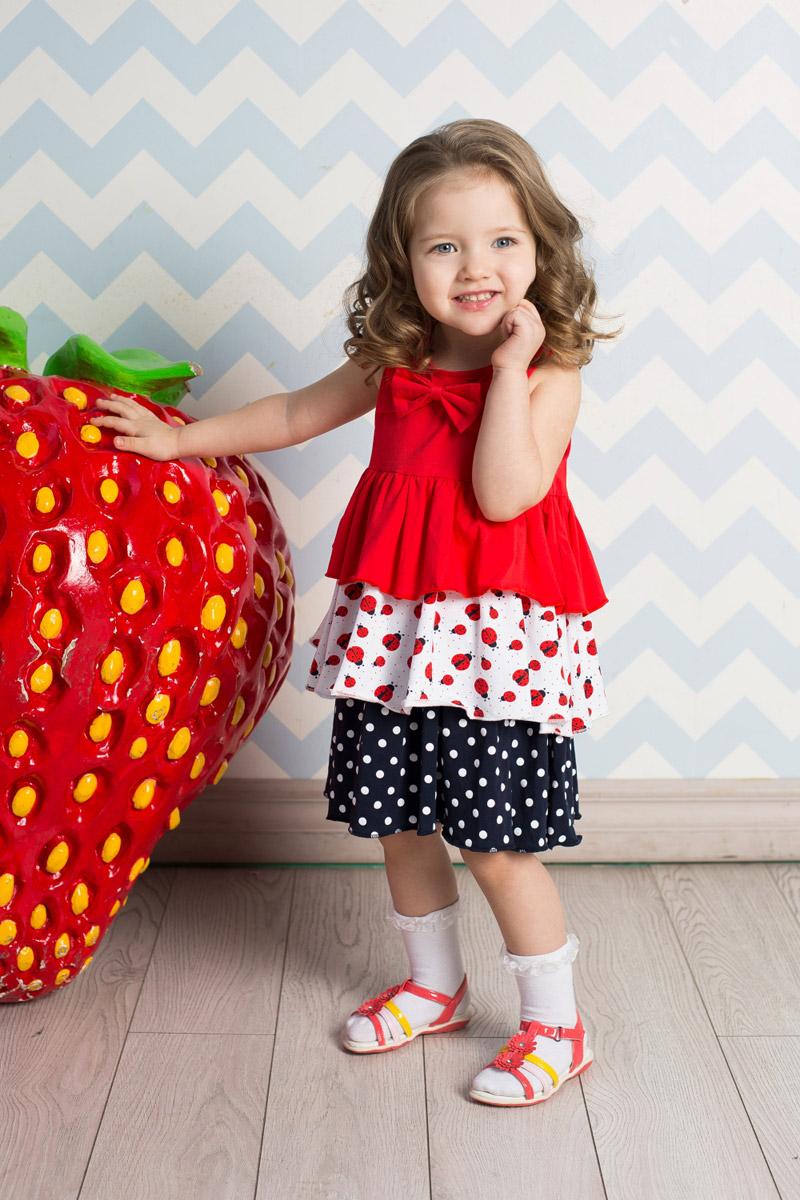 Сарафан712039Яркий сарафан для девочки Sweet Berry выполнен из качественного эластичного хлопка трех цветов. Модель А-силуэта с крупными воланами декорирована бантиком на кокетке.