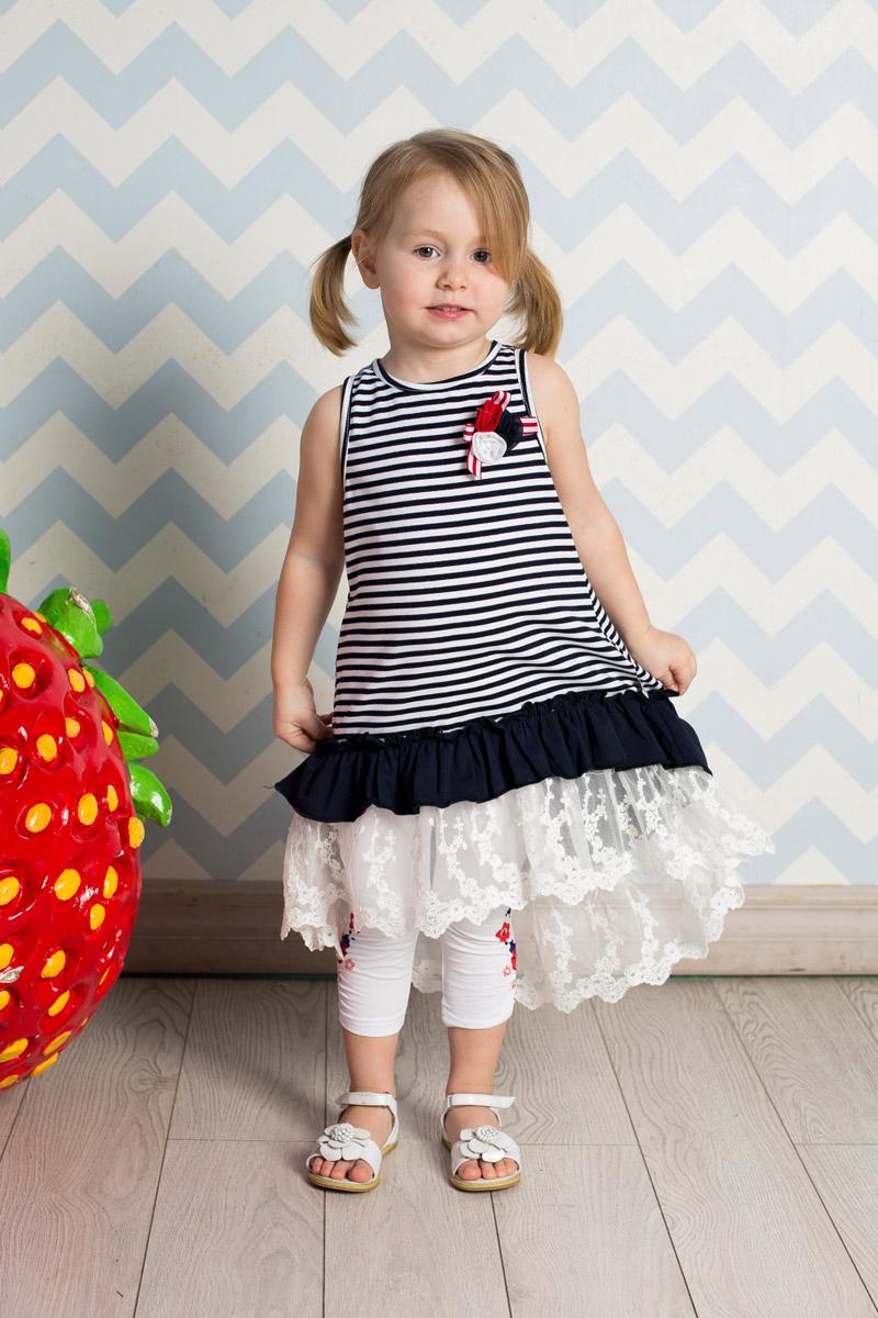 Сарафан712060Яркий сарафан для девочки Sweet Berry выполнен из качественного эластичного хлопка с принтом в полоску и брошью из цветов на кокетке. Модель А-силуэта с удлиненной спинкой дополнена воланами из контрастной ткани и кружев по низу и застегивается на контрастные кнопки на спинке.