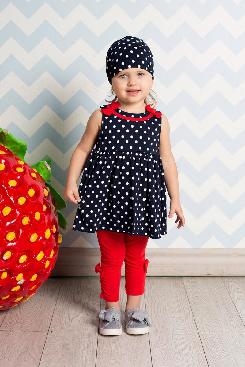 Платье712035Яркое платье для девочки Sweet Berry выполнено из качественного эластичного хлопка и оформлено принтом в горох. Модель с завышенной талией и пышной юбкой застегивается сзади на контрастные кнопки. Кокетка декорирована красной бейкой и бантиками.