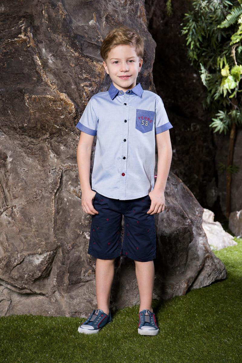Рубашка713020Стильная рубашка для мальчика Sweet Berry, изготовленная из натурального хлопка, станет отличным дополнением к гардеробу вашего ребенка. Модель прямого кроя с короткими рукавами и отложным воротничком застегивается на кнопки. Изделие дополнено накладным карманом с вышивкой. Манжеты рукавов, воротник и карман выполнены из материала контрастного цвета.