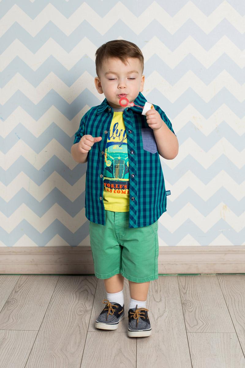 Рубашка711015Стильная рубашка для мальчика Sweet Berry, изготовленная из натурального хлопка с принтом в клетку, станет отличным дополнением к гардеробу вашего ребенка. Модель прямого кроя с короткими рукавами и отложным воротничком застегивается на кнопки. Изделие дополнено накладным карманом контрастного цвета.