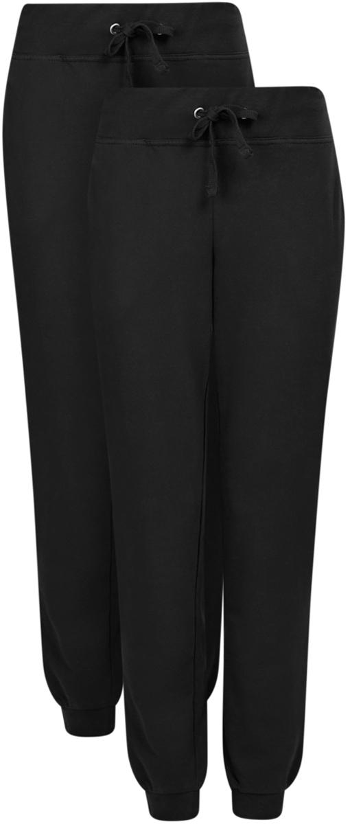 Брюки спортивные16700030-15T2/46173/2300MЖенские спортивные брюки oodji Ultra, выполненные из натурального хлопка, великолепно подойдут для отдыха и занятий спортом. Модель дополнена широкими эластичными резинками на поясе и по низу брючин. Объем талии регулируется с внешней стороны при помощи шнурка-кулиски. Спереди имеются два втачных кармана. В комплекте две пары спортивных брюк.