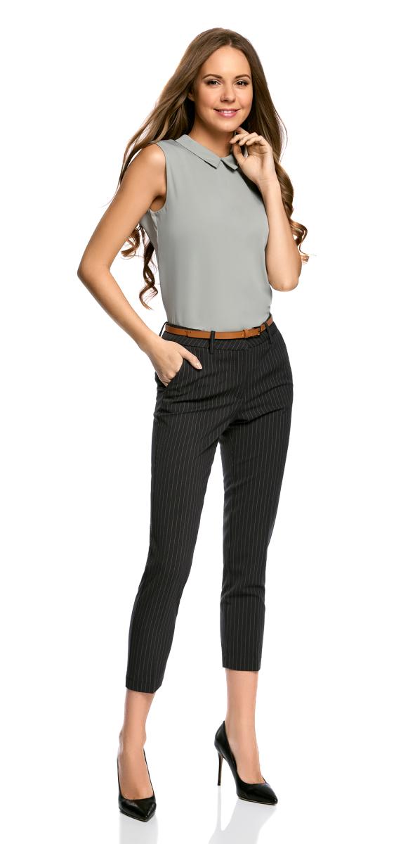 Брюки21706021-3/46347/2973SЖенские классические брюки oodji Collection выполнены из высококачественного материала. Модель стандартной посадки застегивается на пуговицу в поясе и ширинку на застежке-молнии. Пояс имеет шлевки для ремня. Спереди брюки дополнены втачными карманами, сзади - прорезными.