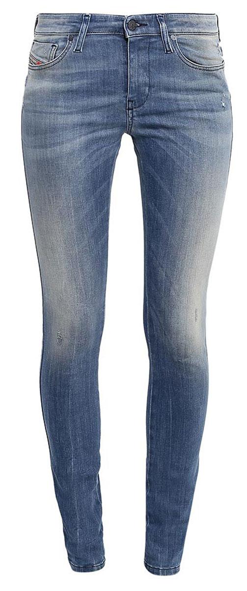 Джинсы00S142-0679W/01Стильные женские джинсы Diesel - это стрейчевые джинсы высочайшего качества на каждый день, которые прекрасно сидят. Модель изготовлена из хлопка и полиэстера с добавлением эластана, имеет силуэт skinny и стандартную талию. Застегиваются джинсы на пуговицу в поясе и ширинку на молнии, на поясе также имеются шлевки для ремня. Спереди модель дополнена двумя втачными карманами и небольшим накладным кармашком, а сзади - двумя накладными карманами. Изделие оформлено потертостями. Эти модные и в то же время комфортные джинсы послужат отличным дополнением к вашему гардеробу.