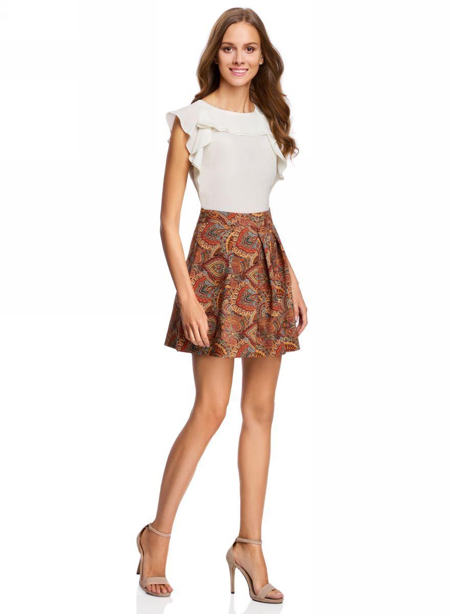 Юбка11600396-2/45559/7533EРасклешенная юбка со встречными складками выполнена из высококачественного материала с этническим рисунком. Модель застегивается на потайную застежку-молнию.