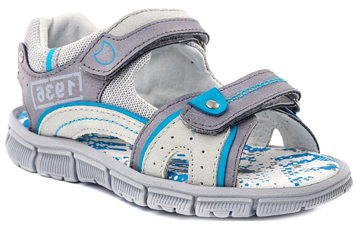 Сандалии524019-22Модные сандалии для мальчика от Котофей выполнены из искусственной кожи и текстиля. Внутренняя поверхность и стелька из натуральной кожи обеспечат комфорт при движении. Ремешки с застежками-липучками надежно зафиксируют модель на ноге. Подошва дополнена рифлением.