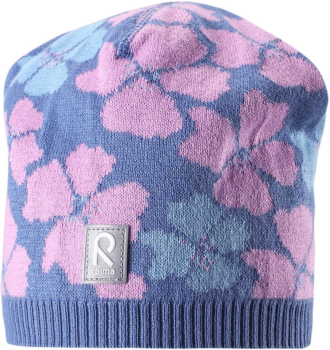 Шапка детская5285230100Удобная детская шапка яркой расцветки рассчитана на межсезонье, в ней можно и поиграть во дворе, и прогуляться по городу. Она изготовлена из мягкого и комфортного вязаного хлопка. Эта облегченная модель без подкладки идеально подходит для солнечной погоды. Яркий сплошной жаккардовый узор будет отлично смотреться.