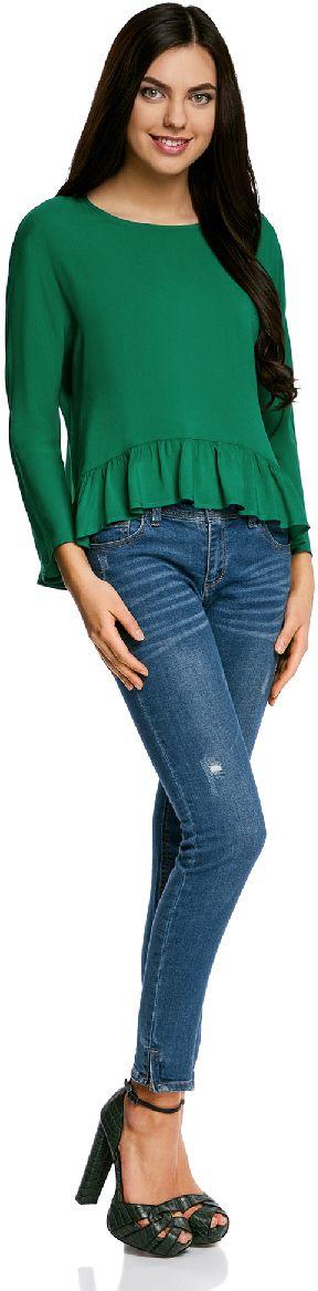 Блузка11405136/46436/2910DБлузка женская oodji Ultra выполнена из высококачественного материала. Модель с круглым вырезом горловины сзади застегивается на пуговицу. Блуза оформлена снизу воланами.