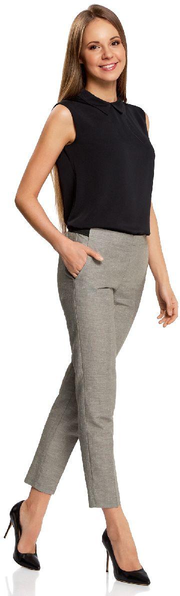 Брюки11706203-6/19801/2312MЖенские укороченные брюки oodji Ultra выполнены из высококачественного материала. Модель стандартной посадки дополнена эластичным поясом. Спереди брюки дополнены втачными карманами, сзади - прорезными.