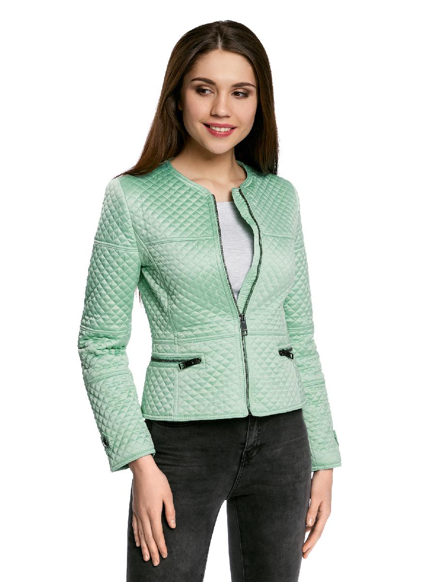 Куртка18304007/46716/3300NЖенская стеганая куртка oodji Ultra выполнена из высококачественного материала. Приталенная модель с круглым воротником застегивается на застежку-молнию. Спереди расположено два втачных кармана на застежках-молниях.
