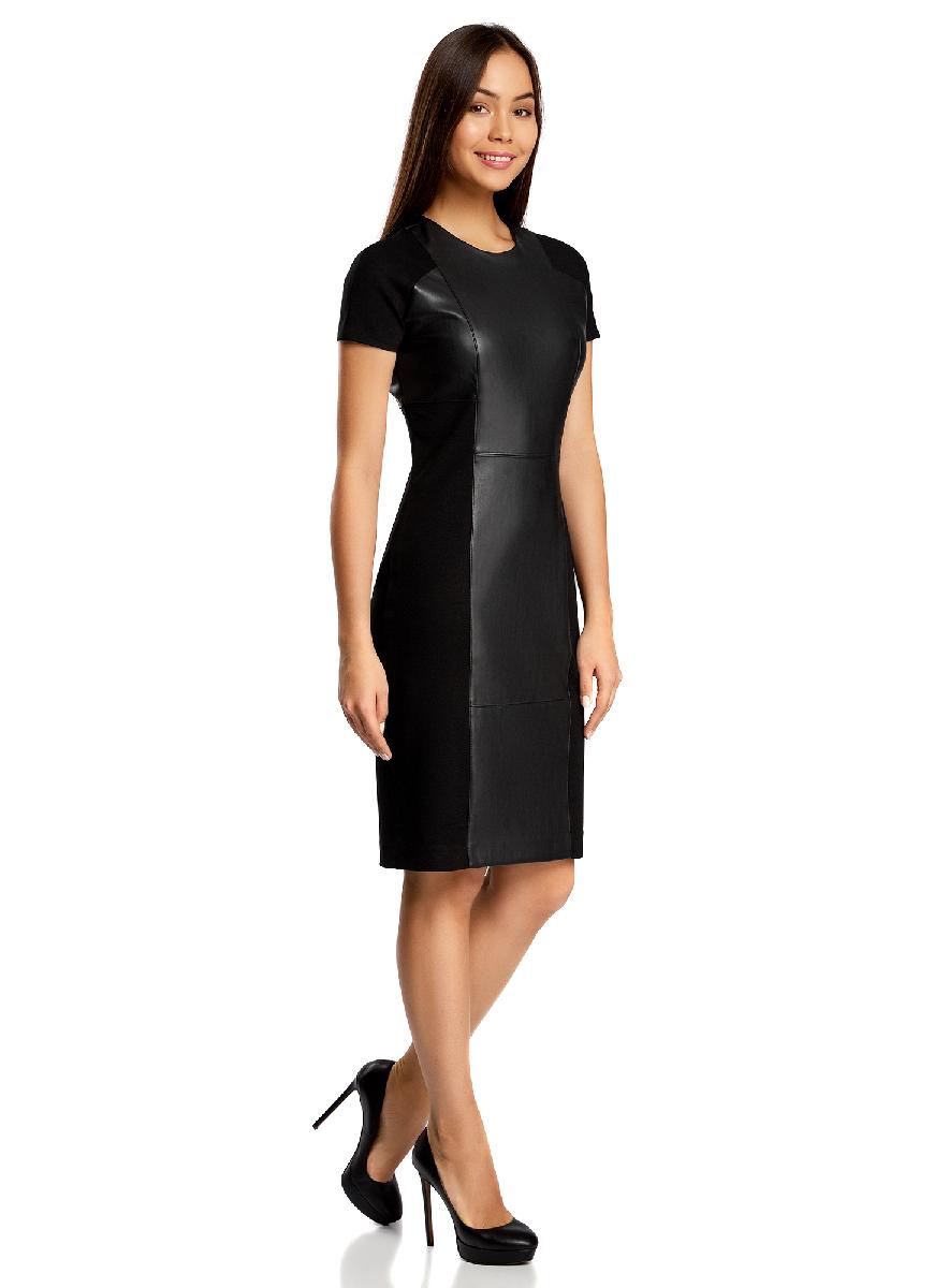 Платье24007023/43060/7900NСтильное платье oodji Collection, выполненное из качественного комбинированного материала, отлично дополнит ваш гардероб. В качестве материала подкладки используется полиэстер. Модель- миди с круглым вырезом горловины и короткими цельнокроеными рукавами оформлена вставками из искусственной кожи. Платье застегивается сзади по спинке на застежку-молнию и дополнено небольшой шлицей.