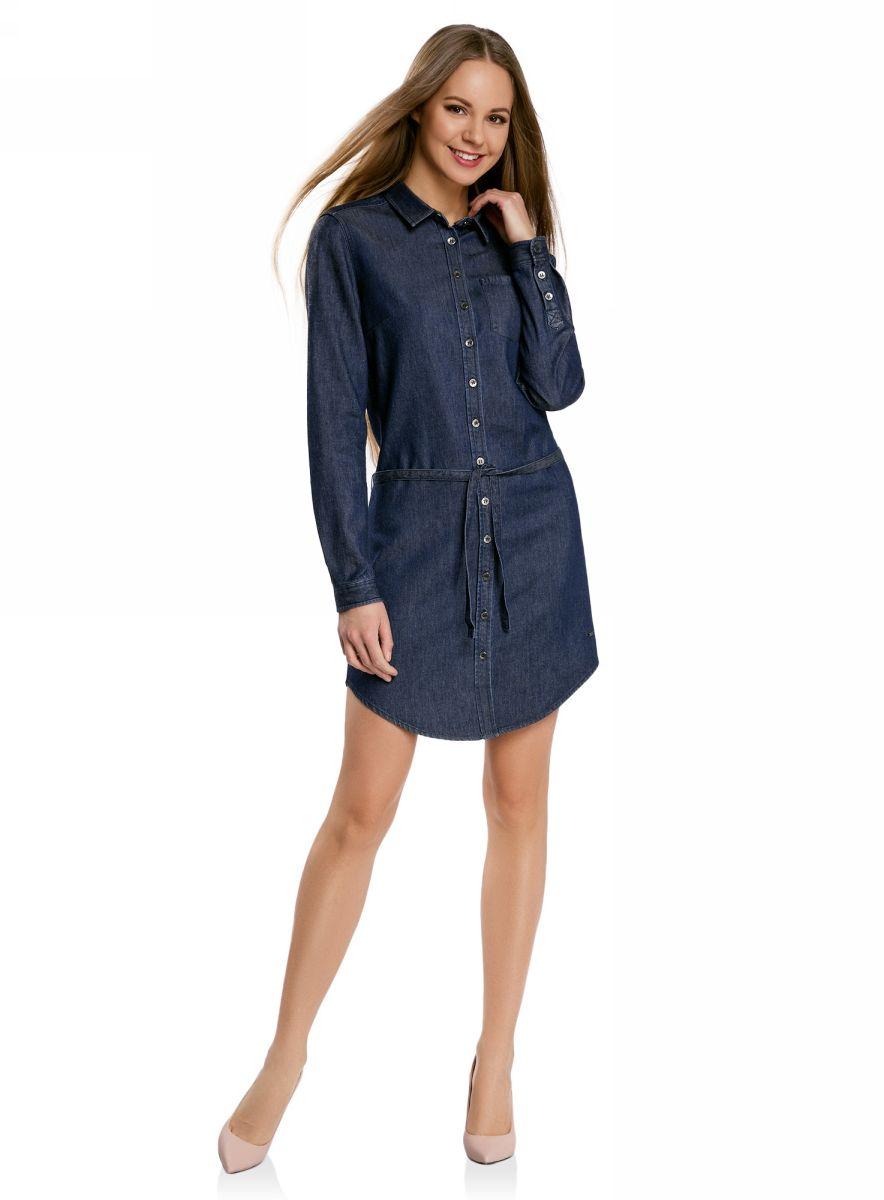 Платье12909044/45251/7900WДжинсовое платье oodji Ultra с закругленным низом - стильное и модное решение на каждый день. Модель средней длины с длинными рукавами и отложным воротничком спереди застегивается на металлические пуговицы по всей длине. На груди изделие дополнено накладным карманом. Рукава также застегиваются на пуговицы. В комплект с платьем входит джинсовый пояс.