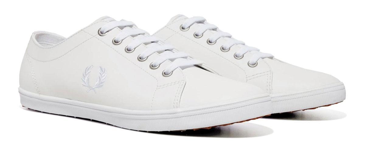 КедыB6237U-183Стильные кеды Kingston Leather от Fred Perry покорят вас с первого взгляда! Модель выполнена из натуральной кожи. Одна из боковых сторон модели оформлена вышивкой в виде логотипа бренда, язычок - вышитыми полосками. Шнуровка обеспечивает надежную фиксацию обуви на ноге. Стелька и подкладка из текстиля гарантируют комфорт при движении. Прочная резиновая подошва с рельефным рисунком обеспечивает сцепление с любой поверхностью. Такие кеды займут достойное место в вашем гардеробе.