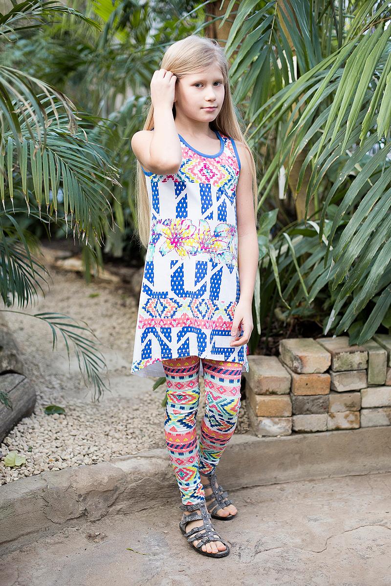 Платье718008Трикотажное платье свободного кроя с ассиметричным низом. Декорировано ярким принтом и контрастной отделкой горловины и пройм.