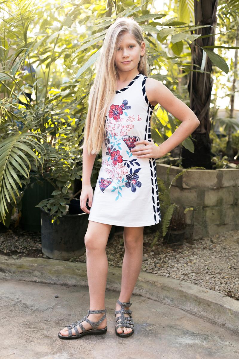Платье718105Трикотажное платье приталенного кроя из комбинированной ткани. Декорировано ярким принтом.