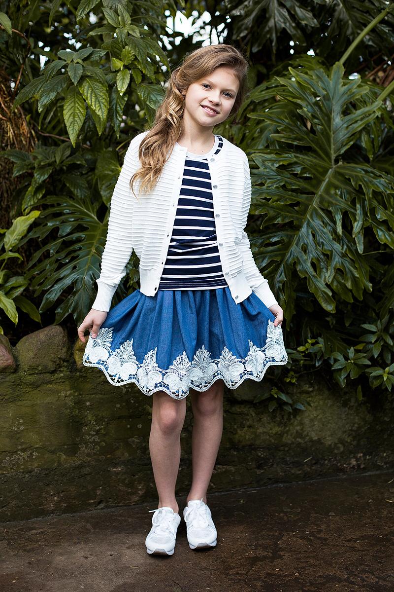 Юбка718121Текстильная юбка для девочки под джинсу. Низ изделия декорирован изящной вышивкой и экокожей. Юбка имеет эластичный мягкий пояс.