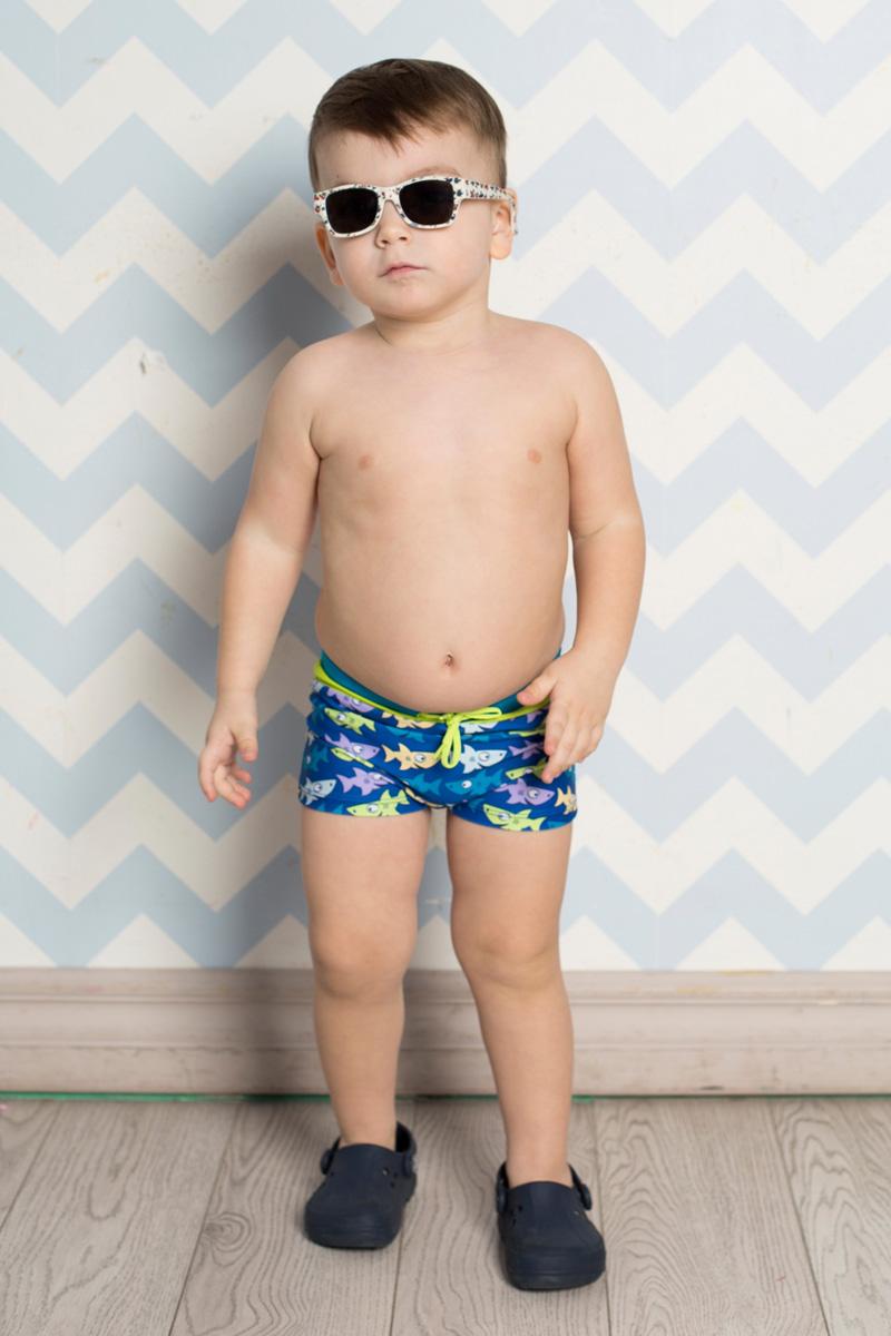 Купальные плавки711055Плавки-боксеры для мальчика Sweet Berry Baby изготовлены из нейлона с добавлением эластана и оформлены оригинальным принтом с изображением акул. Плавки имеют пояс на мягкой эластичной резинке, дополнительно регулируемый шнурком, который не сдавливает живот ребенка и надежно фиксирует изделие на талии. Модель комфортна в носке, быстро сохнет и сохраняет первоначальный вид и форму при длительном использовании.