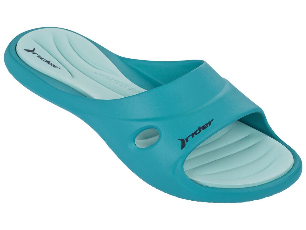 Шлепанцы81907-23404Женские шлепанцы Slide Feet Vii Fem от Rider выполнены из ПВХ. Верх дополнен перфорацией. Стелька из материала ЭВА комфортна при движении. Основание подошвы дополнено рифлением.