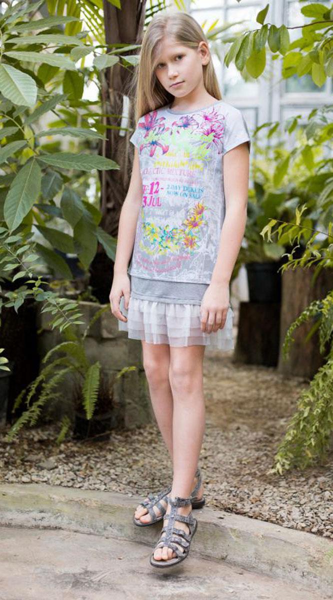 Платье718010Платья свободного кроя для девочки из трикотажной ткани с ярким принтом. Низ изделия декорирован воланом из тафты.