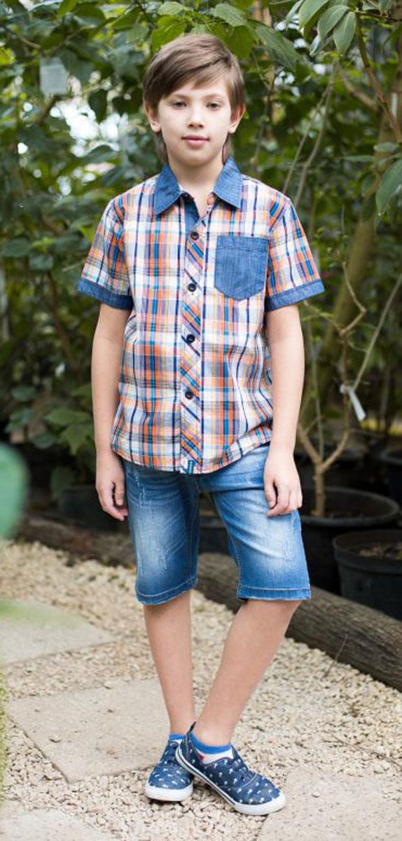 Рубашка717046Текстильная рубашка из хлопка в клетку для мальчика. Короткий рукав, накладной карман на левой полочке. Застегивается на кнопки. Отложной воротничок.