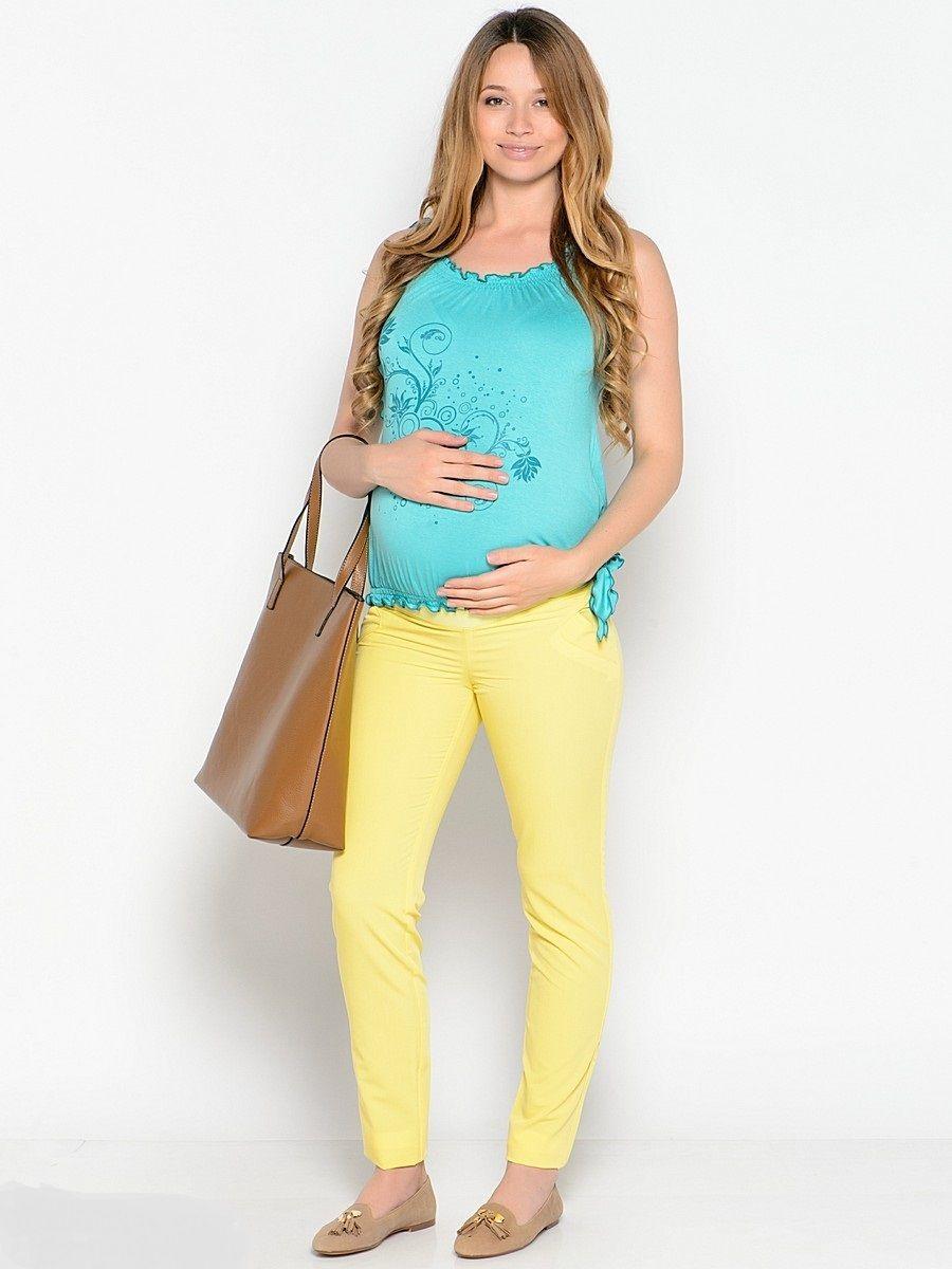 Блузка25265Яркая, стильная блузка, выполненная из мягкого, эластичного трикотажного полотна. Края блузки присобранны на мягкие резиночки, что образует красивые рюшечки и объем для животика в период беременности. После рождения малыша такой фасон скроет временные несовершенства фигуры. Оригинальные завязки на коротких рукавах и по бокам внизу, украшают придают изюминку. Блузка комбинируется с любым низом, подчеркивает женственность образа, обеспечивая комфорт.