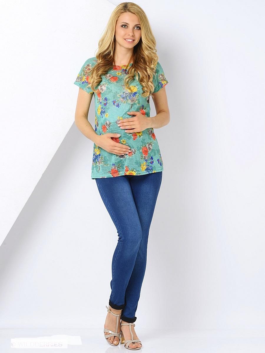 Блузка300308Модная блузка для беременных, из тонкого трикотажного полотна, с коротким спущенным рукавом и вырезом - лодочка, прямой, свободный покрой выгодно обыгрывает силуэт. Женственная блузка порадует вас изумительным принтом насыщенных оттенков и удобным кроем, а благодаря воздушной текстуре ткани Вам будет комфортно и легко в жаркие, летние дни.