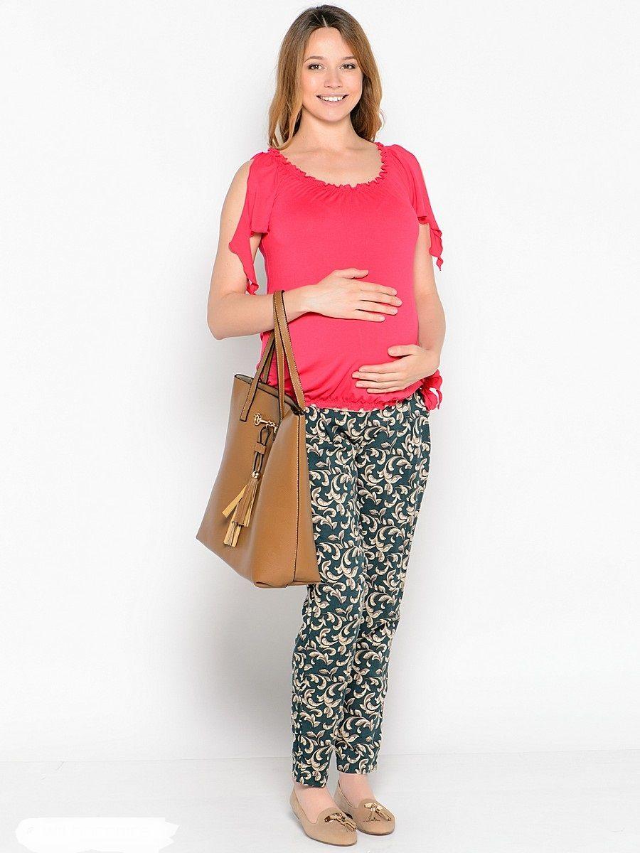 Блузка24265Яркая, стильная блузка, выполненная из мягкого, эластичного трикотажного полотна. Края блузки присобранны на мягкие резиночки, что образует красивые рюшечки и объем для животика в период беременности. После рождения малыша такой фасон скроет временные несовершенства фигуры. Оригинальные завязки на коротких рукавах и по бокам внизу, украшают придают изюминку. Блузка комбинируется с любым низом, подчеркивает женственность образа, обеспечивая комфорт.