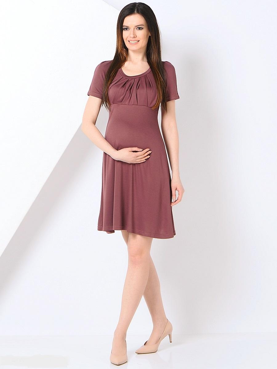 Платье301355Платье для беременных, из трикотажного полотна, с коротким рукавом реглан. Округлый вырез, красиво задрапированный лиф, трапециевидный покрой платья создает элегантный образ уверенной в себе женщины. Благодаря уникальному крою это платье Вы сможете носить на протяжении всего срока беременности и после него. Такое платье идеальный вариант для праздных мероприятий и для работы в офисе.