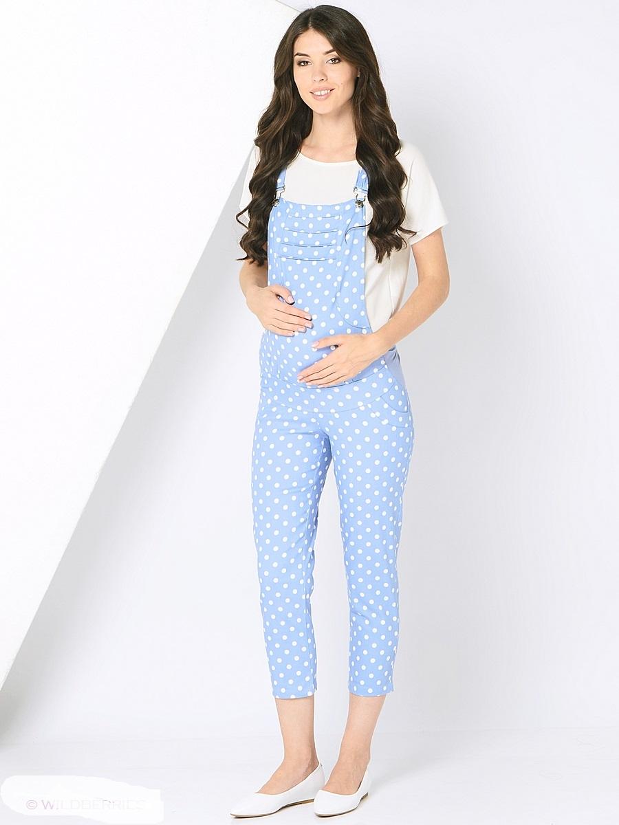 Комбинезон101198Модный комбинезон для беременных с укороченными брючками 7/8, из принтованного материала, с двумя задними карманами. Современная модель с хорошей поддержкой для растущего животика, обхват регулируется с помощью эластичных вставок по бокам и резиночек, бретели так же можно изменять по длине. Комбинезон-прекрасный вариант одежды для будущей мамы, он хорошо садится по фигуре, мягко поддерживает животик, сохраняя свободу и легкость движений на любом сроке беременности.