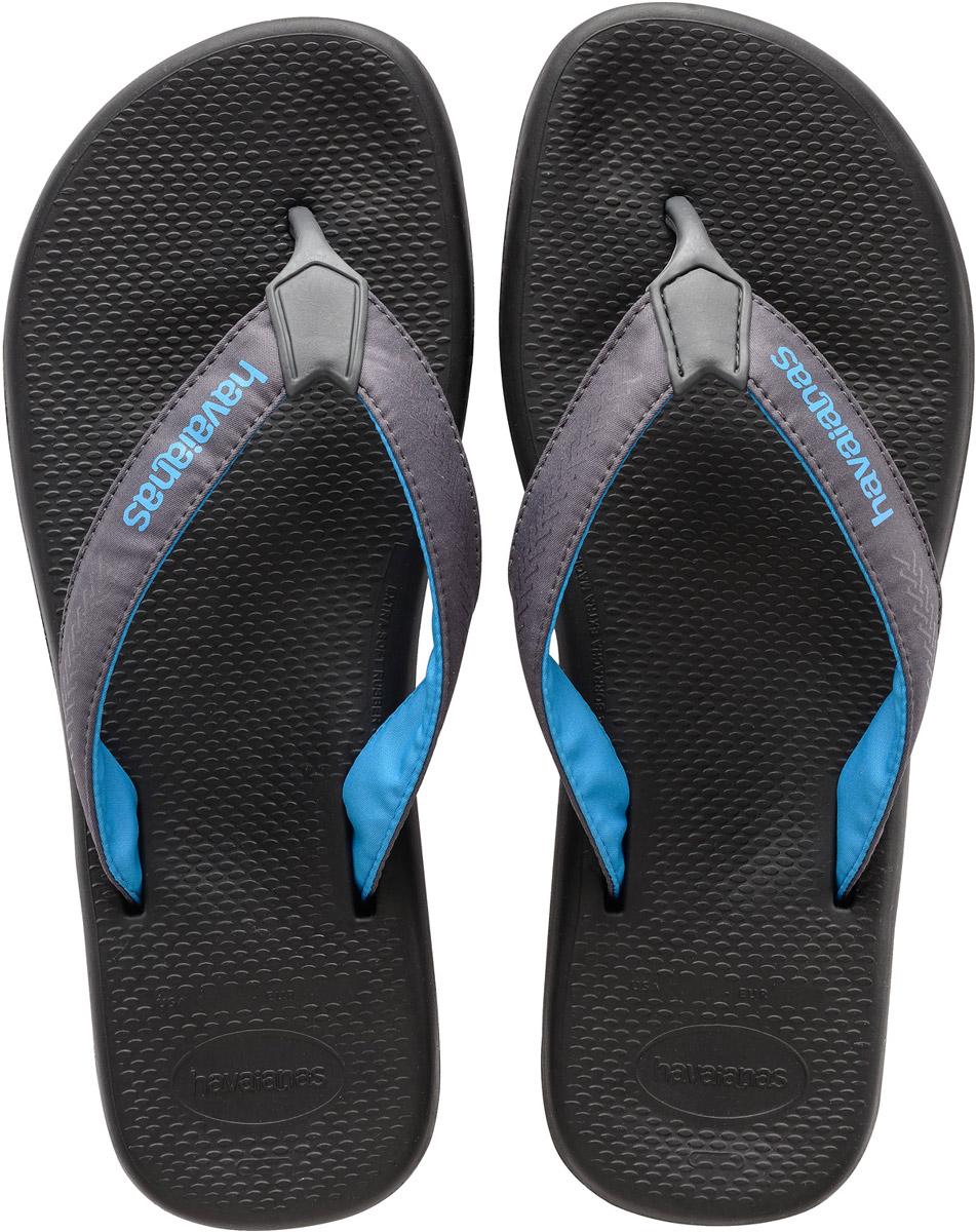 Сланцы4133421-5178Модные мужские сланцы Surf Pro от Havaianas придутся вам по душе. Верх модели, выполненный из резины и текстиля, оформлен оригинальным орнаментом и названием бренда. Ремешки с перемычкой гарантируют надежную фиксацию модели на ноге. Резиновая подошва комфортна при движении. Рифление на верхней поверхности подошвы предотвращает выскальзывание ноги. Рельефное основание подошвы обеспечивает уверенное сцепление с любой поверхностью. Удобные сланцы прекрасно подойдут для похода в бассейн или на пляж.