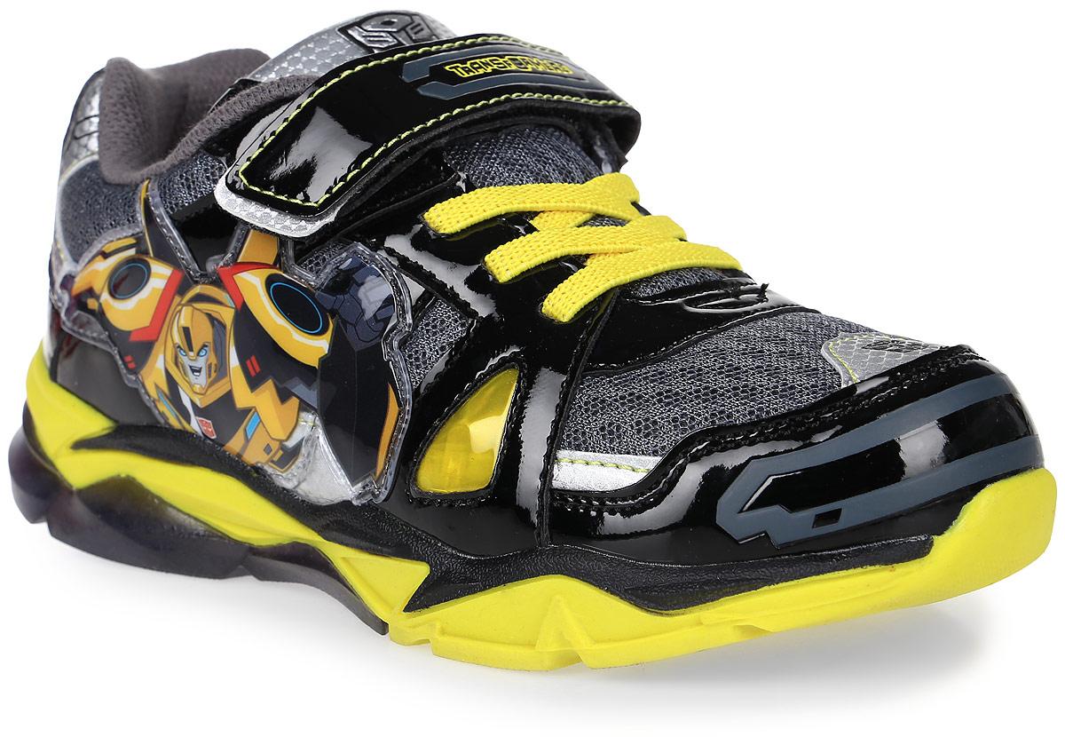 Кроссовки6759AСтильные кроссовки Transformers от Kakadu - отличный выбор для вашего мальчика на каждый день. Верх модели выполнен из дышащего текстиля и искусственной кожи. Кроссовки оформлены принтом по мотивам знаменитых Трансформеров. Ремешок с застежкой-липучкой и шнуровка обеспечивают надежную фиксацию обуви на ноге. Подкладка из мягкого хлопка обеспечивает комфорт при носке. Съемная текстильная стелька удобна в эксплуатации и позволяет быстро просушивать обувь. Подошва выполнена из износостойкой резины. Рифление на подошве обеспечивает отличное сцепление с любой поверхностью. Модные и комфортные кроссовки - необходимая вещь в гардеробе каждого ребенка.