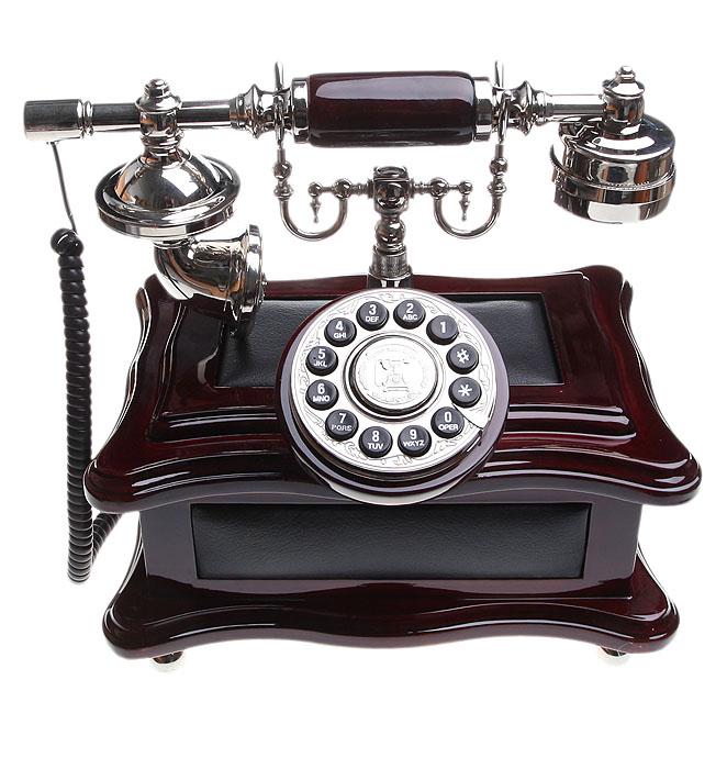 Телефон-ретро36126Оригинальный ретро-телефон - это великолепный подарок к празднику, который станет центром внимания и обязательно порадует Ваших друзей и близких! Деревянный корпус и трубка со старинным микрофоном привнесут в Ваш дом неповторимое очарование стиля начала XX века. Телефон-ретро - не просто украшение! Уникальный дизайн под старину прекрасно сочетается с полным перечнем функций современного стационарного телефона: кнопочным набором, пульсовым и тоновым режимами и др. Изысканная деталь интерьера и комплимент Вашему вкусу!
