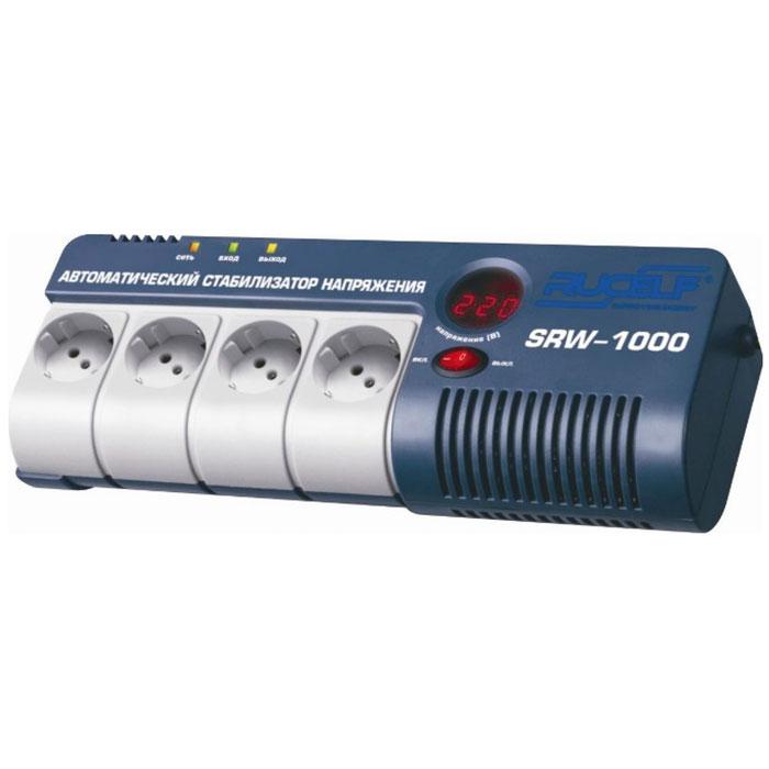 Rucelf SRW-1000-D cтабилизатор напряжения релейный00001304Навесной стабилизатор напряжения Rucelf SRW-1000-D предназначен для точного и быстрого выравнивания сетевого напряжения во избежание поломки дорогостоящей бытовой техники. Устройство обеспечивает эффективную защиту приборов с потребляемой мощностью не более 900 Вт. Релейный тип стабилизации является одним из наиболее надежных. Светодиодная индикация и цифровой дисплей позволяют контролировать состояние устройства и величину выходного напряжения. Светодиодная индикация сети, входного и выходного напряжения позволяет контролировать рабочее состояние устройства. Стабилизатор оснащен цифровым дисплеем, отображающим величину выходного напряжения. Устройство оборудовано четырьмя евророзетками для одновременного подключения до четырех бытовых приборов без использования разветвителей. Корпус навесного стабилизатора напряжения Rucelf SRW-1000-D имеет специальные отверстия, предотвращающие перегрев внутренних узлов.