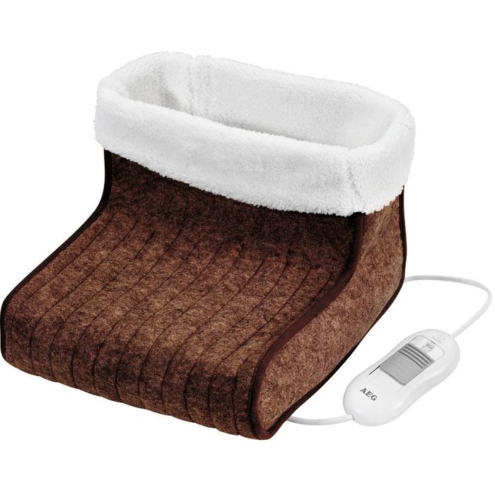 AEG FW 5645, Brown White электроваленкиFW 5645 brown-weissЭлектроваленки AEG FW 5645 отлично подойдут для дома и дачи. Сохраняют ноги в тепле даже в самую холодную зиму. Оснащены электронной регулировкой температуры для постоянного нагрева. Имеют 3 степени регулировки температуры. Внутренняя обивка изготовлена из легко чистящейся шерсти, которую можно снимать и стирать в машине. Наружная поверхность выполнена плотного полиэфира. Электроваленки подходят для обуви до 46-го размера.
