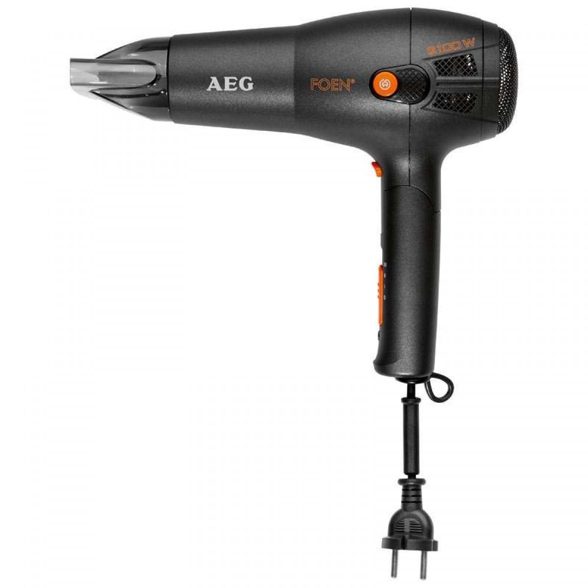 AEG HT 0 Ionic, Black фенHT 0 schwarz ionicСистема ионизации внутри фена генерирует отрицательные ионы, которые обеспечивают натуральный блеск и здоровье волос, устраняя эффект наэлектризованности. Очень удобен и практичен в использовании, благодаря эргономичной ручке с автосматывающимся шнуром и кнопкам управления, которые находятся под ручкой