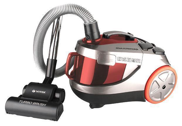 Vitek VT-1838(R) пылесосVT-1838(R)Vitek VT-1838 R – это простой и удобный в использовании пылесос c аквафильтром и дополнительным сборником для сухой пыли, который будет вашим незаменимым помощником для поддержания чистоты и влажности воздуха дома. Несмотря на компактный размер, представленная модель обладает невероятно высокими показателями потребляемой мощности 1800 Вт и мощностью всасывания 400 Вт. 7 ступеней системы фильтрации способны задержать даже мельчайшие частицы пыли и микроорганизмов, что гарантирует вам эффективную защиту органов дыхания от раздражения. А благодаря оснащению модели аквафильтром с емкостью для воды 0, 5 л, вы сможете производить уборку длительное время без понижения мощности всасывания. В комплектацию пылесоса Vitek VT-1838 R входит универсальная насадка пол/ковер, щетка для очистки мягкой мебели, щелевая насадка для уборки в труднодоступных местах и щетка для пыли. Кроме того, отличным дополнением является наличие в комплекте турбощетки, позволяющей более эффективно производить...