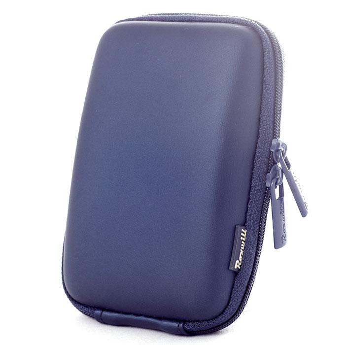 Roxwill C40, Dark Blue чехол для фото- и видеокамерC40 dark blueRoxwill C40 - надежный чехол для компактных фотокамер. Он гарантированно защитит вашу камеру от случайных ударов и царапин, а также от пыли и влаги. Изделие изготовлено из EVA (вспененная резина). Данный материал не подлежит воздействию агрессивных веществ и предохраняет фотоаппарат при падении. Для переноски предусмотрен регулируемый шейный ремешок и возможность крепления на поясном ремне.