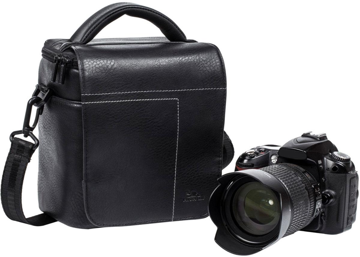 Riva 7612 SLR Case, Black сумка для зеркальной фотокамеры6584Сумка для зеркальной фотокамеры с установленным объективом Riva 7612 SLR Case из высококачественной искусственной кожи имеет верхний откидной клапан на магните, который закрывает основное отделение на молнии. Внутренние передвижные перегородки позволят удобно разместить дополнительный объектив, вспышку. Два внутренних кармана служат для хранения аксессуаров и карт памяти, как и два дополнительных наружных кармана. Для переноски предусмотрены регулируемый наплечный ремень с мягкой накладкой и удобная ручка.
