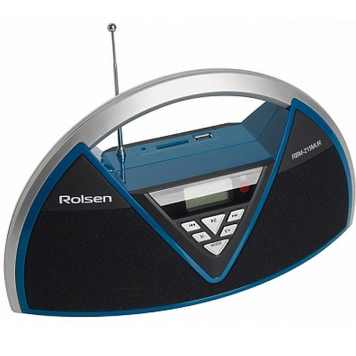 Rolsen RBM-215MUR, Black Blue радиоприемник1-RLAM-RBM215MURBUРадиоприемник Rolsen RBM-215MUR станет вам незаменимым спутником. Дизайн устройства специально разработан для удобного использования дома, в офисе или путешествии: легкий, компактный, с удобной ручкой для переноски, и съемным аккумулятором для автономной работы. Устройство оснащено высокочувствительным тюнером и обеспечивает точную настройку и качественный прием любимых радиостанций. Жидкокристаллический дисплей c голубой подсветкой, отражает всю необходимую информацию. Радиостанции можно слушать через акустическую систему, мощные динамики 2 x 2 Вт обеспечивают отличный звук, или через наушники (приобретаются отдельно). Повторение трека Повторение всех треков Пауза Форматы файлов Воспроизведение файлов с устройств, подключенных по USB Воспроизведение файлов с карт памяти SD Радио тюнер FM Тип тюнера цифровой Диапазон частот FM Радио: 87,5-108 мГц Дисплей Линейный вход AUX IN USB порт SD слот Питание: 220/240...