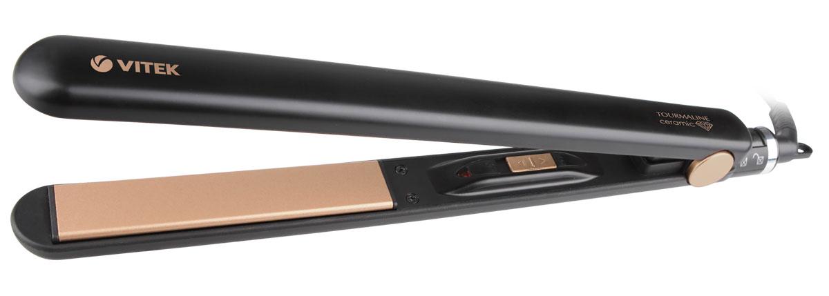 Vitek VT-2317 (BK) выпрямитель для волосVT-2317(BK)Выпрямитель для волос Vitek VT-2317 (BK) справится даже с самым непослушными волосами. Данная модель оснащена качественным керамическим турмалиновым покрытием пластин, а также функцией изменения температуры в зависимости от типа волос. Выпрямитель прост в использовании благодаря стильному эргономичному дизайну. Защита от перегрева Индикация включения Ширина пластин: 25 мм Блокировка ручки