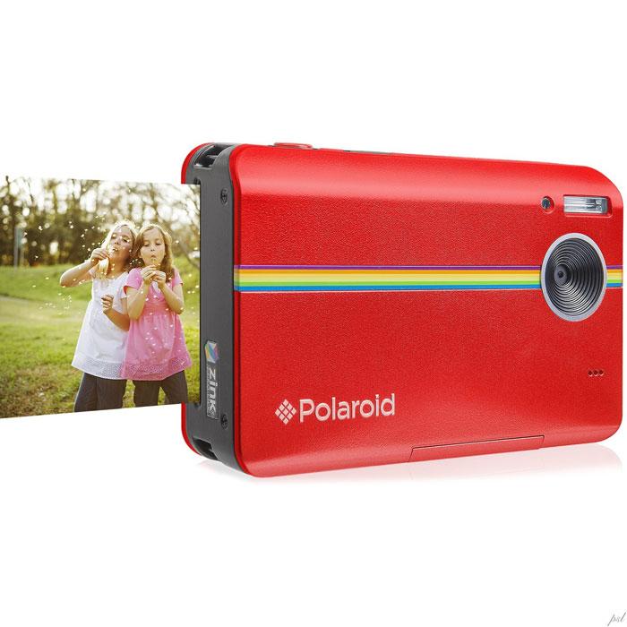 Polaroid Z2300, Red моментальная фотокамераPOLZ2300RРассматривайте ваши фотографии вживую сразу после снимка вместе с новой моментальной цифровой камерой Polaroid Z2300. Благодаря интегрированной в камере системе печати ZINK вы сможете печатать фотографии прямо на месте съемки. Всего менее чем за одну минуту вы и ваши друзья получите копии ваших фотографий без использования компьютера или принтера. Вы даже можете обрезать снимок перед тем, как пустить его в печать для того, чтобы получить изображение именно таким, каким захотите вы. Эта цифровая камера Полароид оборудована 3-дюймовым LCD дисплеем для удобного просмотра снимков. 10-мегапиксельная матрица гарантирует, что ваши снимки получатся такими же четкими и яркими, как в жизни. Цифровой зум 2.4x Моментальная печать фото 2х3 дюйма Время печати одного снимка 60 сек