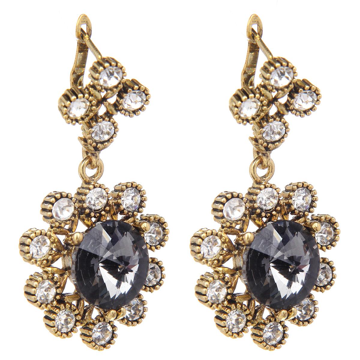 Серьги Taya, цвет: черный, золотистый. T-B-9447-EARR-GL.HEMATITET-B-9447-EARR-GL.HEMATITEСерьги Taya изготовлены из ювелирного сплава на основе латуни. Сплав не содержит свинец и никель. Серьги выполнены из металла золотистого цвета в виде объемного цветка, лепестки которого декорированы крупными стразами. Серьги застегиваются на английский замок. Оригинальные серьги модного дизайна создают яркий и запоминающийся образ.