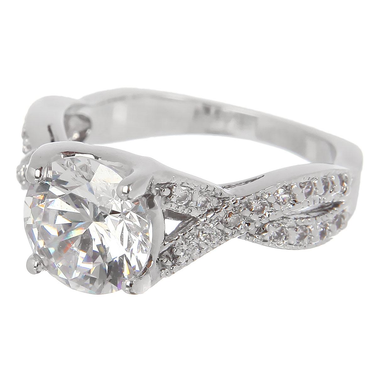 Кольцо Taya, цвет: серебристый. T-B-4777T-B-4777-RING-RHODIUMВеликолепное кольцо Taya выполнено из гипоаллергенного сплава на основе латуни с родиевым покрытием. Изделие дополнено стразами и камнем. Такое кольцо станет украшением любого наряда. Кольцо подчеркнет вашу яркую индивидуальность и поможет создать неповторимый образ.