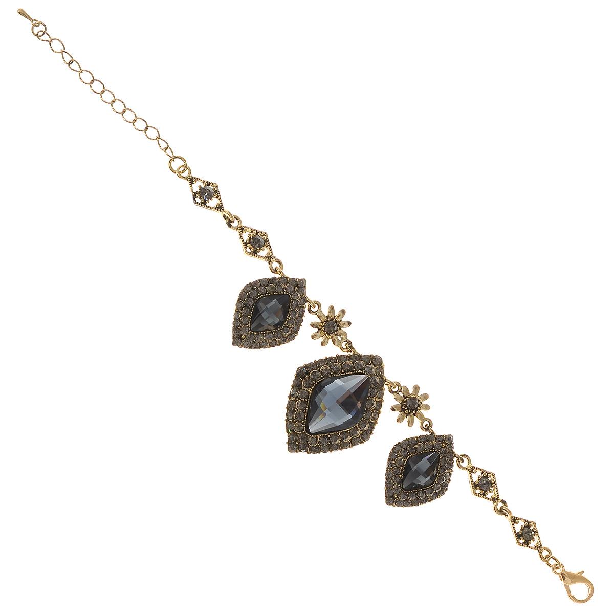Браслет Taya, цвет: золотистый, пурпурный. T-B-7539T-B-7539-BRAC-GL.HEMATITEВеликолепный браслет Taya изготовлен из гипоаллергенного металлического сплава золотистого цвета. Браслет выполнен под старину и дополнен подвесками в виде ромбов с камнями серо-голубого цвета и окантовкой из страз. Изделие застегивается на замок-карабин с регулирующей длину цепочкой. Это украшение прекрасно дополнит ваш повседневный образ и внесет в него изюминку.