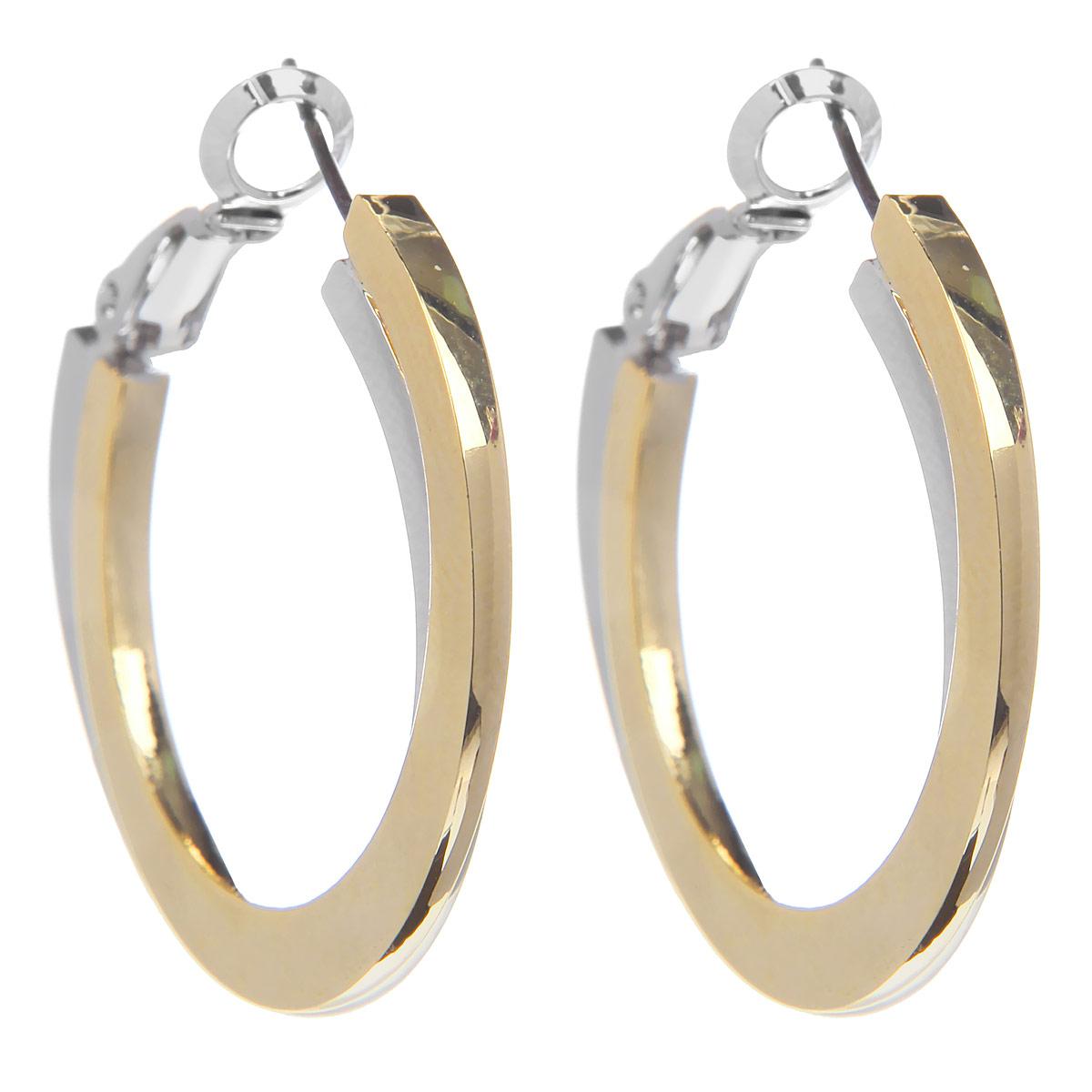 Серьги Taya, цвет: серебристый, золотистый. T-B-6092T-B-6092-EARR-SL.GOLDОригинальные серьги Taya, выполненные из гипоаллергенного сплава на основе латуни, представляют собой соединенные кольца из металла золотистого и серебристого оттенка. Имеют надежную застежку в виде булавки, что обеспечивает надежное удержание серьги. Такие серьги позволят вам с легкостью воплотить самую смелую фантазию и создать собственный, неповторимый образ.