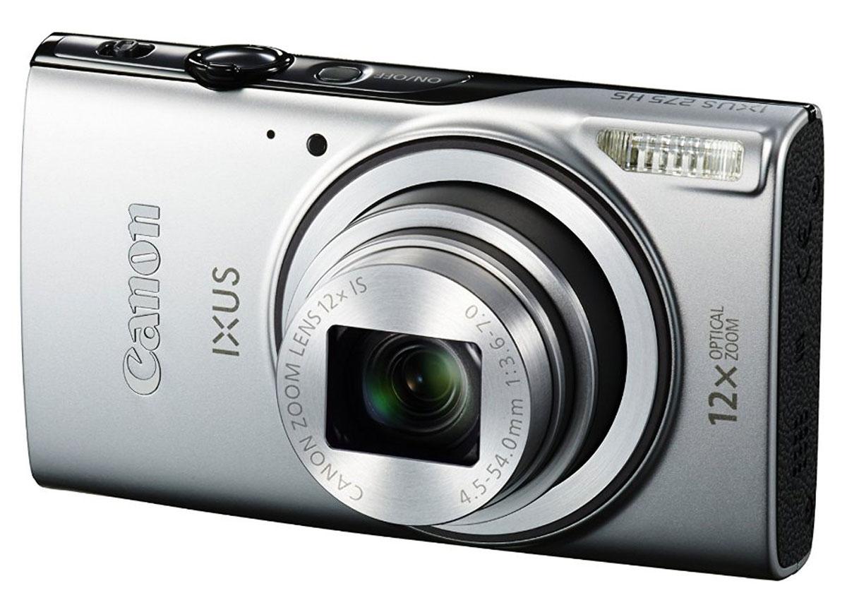 Canon IXUS 275 HS, Silver цифровая фотокамера0159C001Куда бы вы ни отправились, эта стильная высокопроизводительная камера Canon IXUS с 12x зумом в тонком корпусе позволит вам легко создавать потрясающие фотографии и видео Full HD, а также наслаждаться удобным обменом файлами с помощью Wi-Fi и NFC. Все, что нужно для безупречной съемки, - у вас в кармане: Компактная сверхтонкая камера IXUS 275 HS со стильной металлической отделкой оснащена всеми функциями, необходимыми для создания и демонстрации фотографий и видеороликов превосходного качества. Запечатлейте каждую деталь без потери качества: Мощный объектив с зумом 12x и зумом 24x при использовании функции ZoomPlus позволяет максимально приближать отдаленные объекты без ущерба для резкости или детализации изображения. Серхширокоугольный объектив 25 мм увеличивает охват кадра, что идеально подходит для съемки групповых фотографий и панорамных пейзажей. Оставайтесь всегда на связи: Делитесь своими творениями со всем миром...