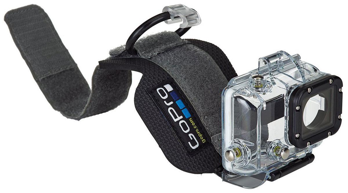 GoPro Wrist Housing, Black крепление для экшн-камерыAHDWH-301Носите уникальное крепление GoPro Wrist Housing на руке словно часы! Создавайте кадры прямо на лету! Крепление не только надежно, но и очень удобно: поворачивайте камеру в нужном направлении и снимайте красочные видео и фотокадры. Крепление-бокс на руку – это не просто аксессуар, это ваш комфорт. Один из лучших вариантов для серфинга, сноубординга, альпинизма и катания на лыжах. А водонепроницаемый бокс позволит любителям дайвинга создавать не только яркие фото и видео, но и чувствовать себя свободно и удобно, не отвлекаясь от красот подводного мира. При необходимости крепление можно фиксировать на лыжных перчатках или на рукаве куртки. Регулируется до нужных размеров и будет комфортен даже ребенку.