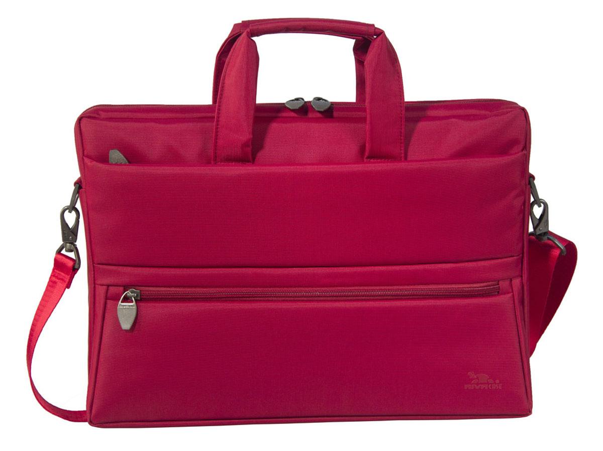 Riva 8630 сумка для ноутбука 15,6, RedRivaCase 8630 redСумка Riva 8630 для ноутбука до 15.6 выполнена из плотного синтетического материала и имеет утолщенные стенки для лучшей защиты ноутбука от случайных ударов и царапин, а также от пыли и влаги. Внутренняя контрастная подкладка серебристого цвета. Два дополнительных внутренних отделения помогут удобно разместить все необходимые документы и планшет до 10.1. Два внешних передних кармана на молнии служат для хранения аксессуаров, флэш-накопителей, визитных карт, смартфона. Дополнительное отделение на задней панели предназначено для хранения аксессуаров, документов. Двойная застежка молния предоставляет удобный доступ к устройству. Удобные ручки для транспортировки и регулируемый, съемный плечевой ремень с мягкой накладкой обеспечат удобство переноски.