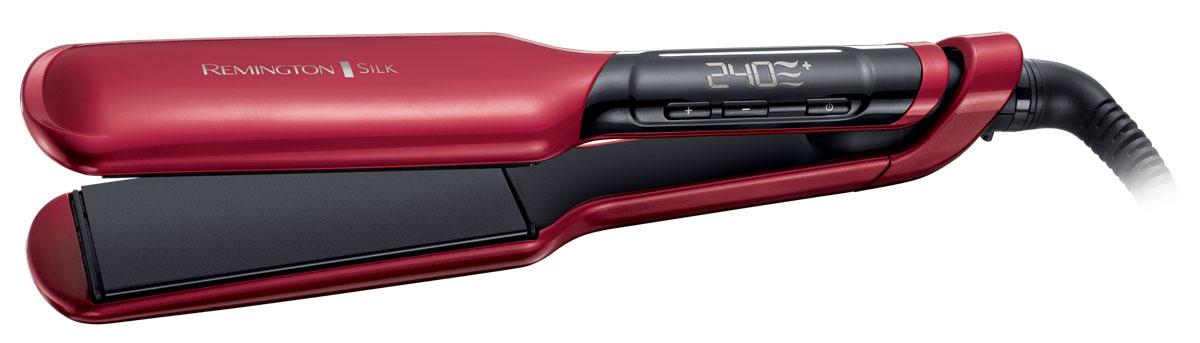 Remington S9620 выпрямитель для волосS9620Remington S9620 - самый быстрый и мощный выпрямитель Remington, с помощью которого вы сможете создать укладку салонного качества. В данной модели удачно используются усовершенствованная керамика и роскошный шелк, что делает покрытие в 2 раза более гладким. Широкие пластины выпрямителя содержат протеины шелка, а значит даже самые непослушные волосы станут идеально гладкими и шелковистыми. Благодаря регулировке температурного режима этот выпрямитель подойдет для любого типа волос. Кроме того, на цифровом экране выпрямителя будет показана наиболее подходящая температура для вашего типа волос - таким образом ваши волосы будут защищены от чрезмерного перегрева. Также на экране будет отражаться текущая температура нагрева для полного контроля. Размер пластин: 110 x 51 мм Блокировка кнопок нагрева Функция памяти – запоминает последние использованные настройки температуры